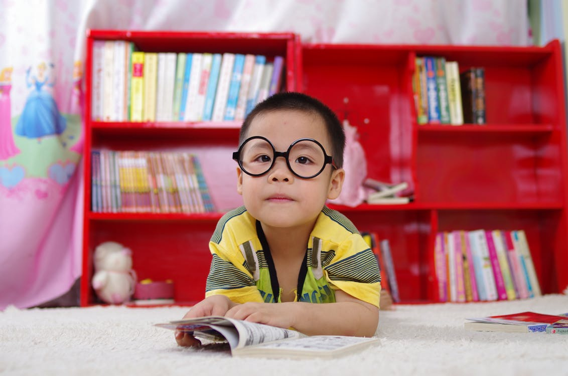 Small child with glasses, parody of someone trying to understand the jargon in UK pension advice